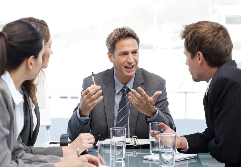 Charismatic chairman talking with his team - iStock_000015274697_Medium